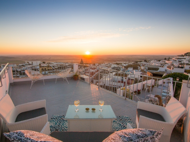 Sun sets over the Bay of Cadiz from the roof terrace of Casa La Muralla