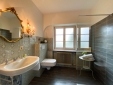 livingroom with red sofa on the 1st floor overlooking the garden