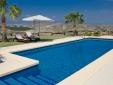 The pool area with views at Cortijo El Sarmiento