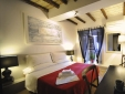 A romantic room ensuite with timber ceilings and 'parquet floors
