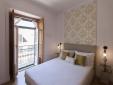 Otilia Apartments Lisbon Portugal Bedroom with Balcony