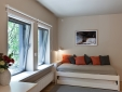 Orange Apartment: Living room with sofa bed