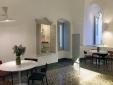 living room with dining area  Palazzina Alchimia Fasano Puglia