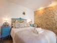 Romantic bedroom with exposed 9 century fortress wall