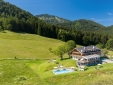 "chiemsee chalet balcony with private hot tube ""Bergwiesen-Chalet-Suite"""